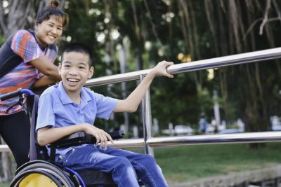 estate planning for disabled beneficiary | parent pushing child in wheelchair