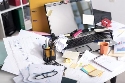 cluttered desk looking for loved one's original will