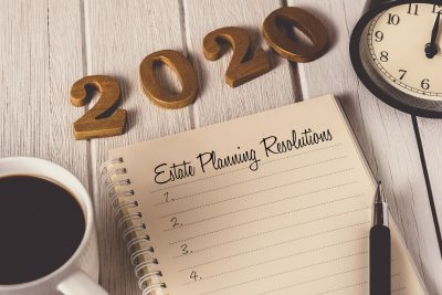 """2020"" numerals with notebook page reading ""estate planning resolutions"""