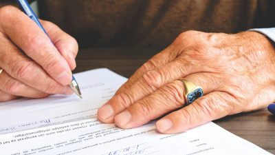 man signing last will