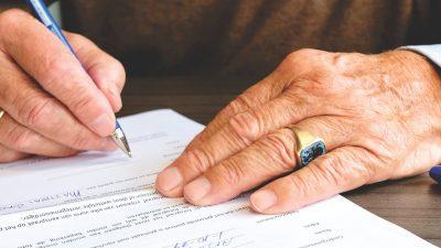 man signing last will